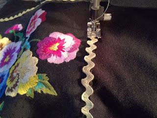sew on ric rac on fleece cushion cover craftrebella