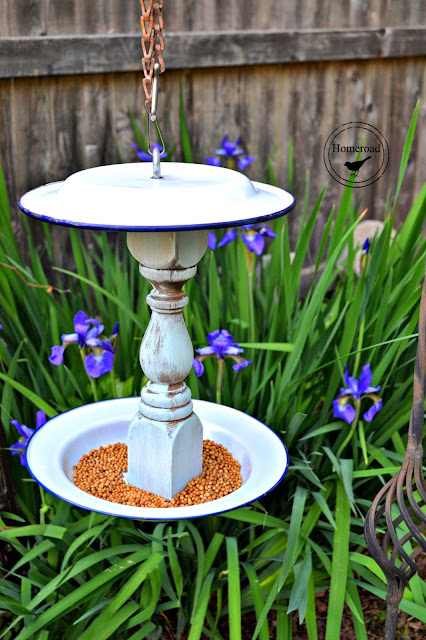 Hanging bird feeder made with enamelware plates