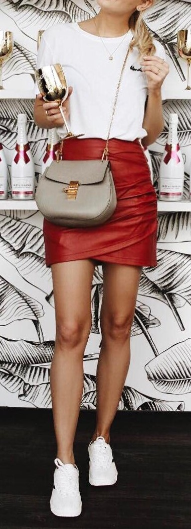 Cute street style outfit idea: top + skirt + bag