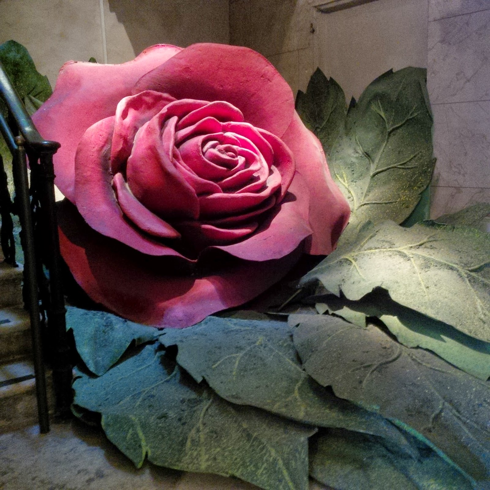 The huge rose at the bottom of the stairs in Arena Museo Opera in Verona