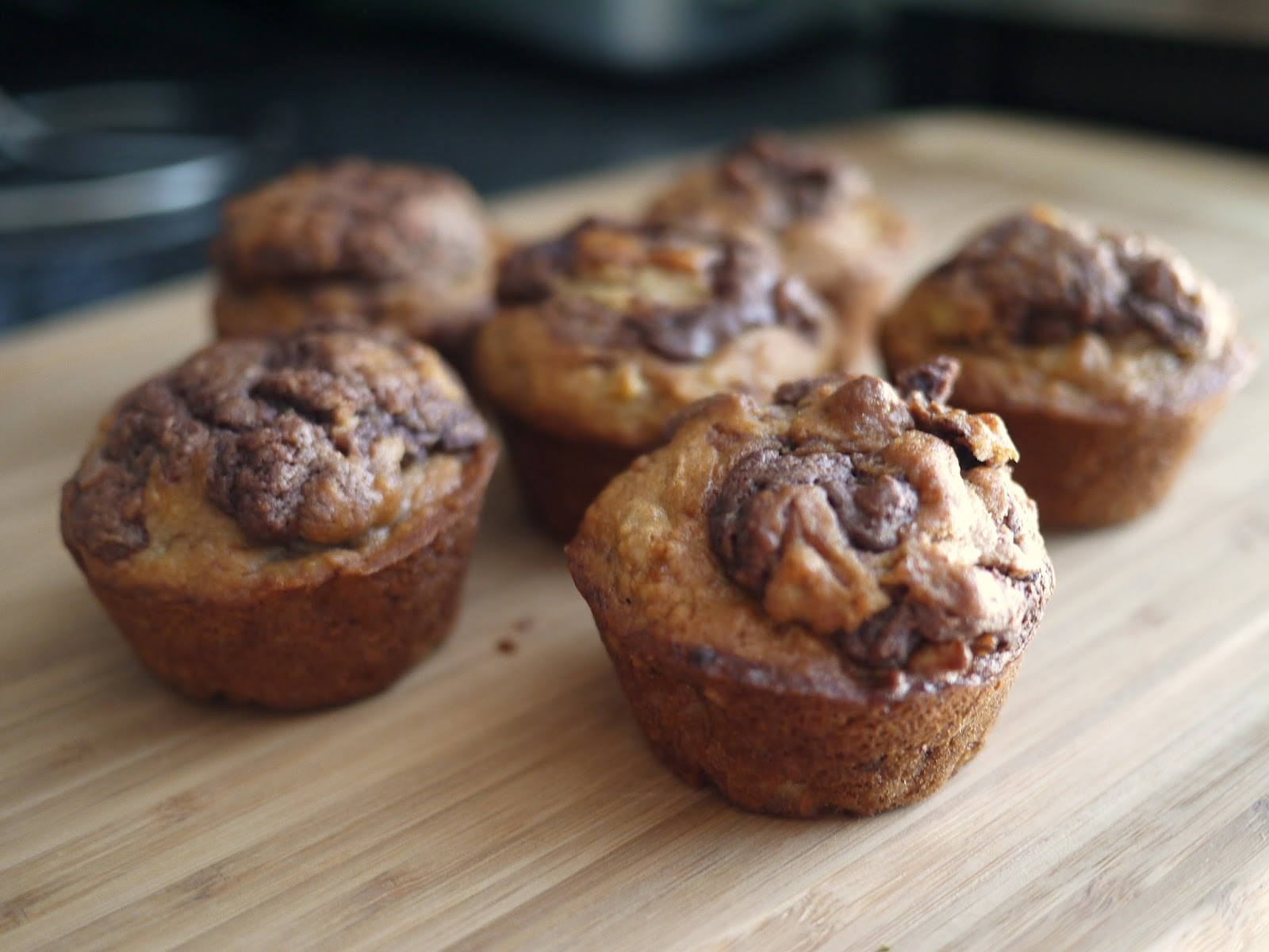 Hazelnut swirl banana nut muffins the tasteful me the recipe is adapted from tyler florence on food network but with a twist chocolaty swirl three ripe bananas ensure soft moist bites every time a forumfinder Images