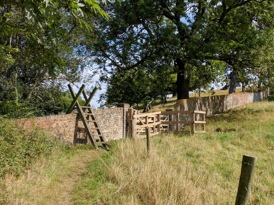 Photograph of a stile over a stone wall on Walk 57: Chapmore End Loop