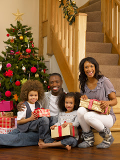 Photo of an African-American Family Portrait by the Christmas Tree
