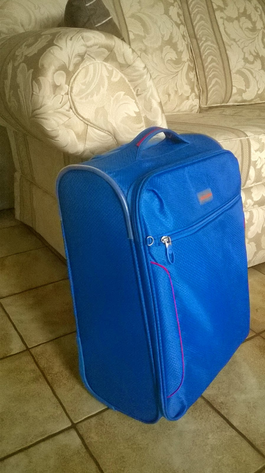 Small blue suitcase, carry-on luggage