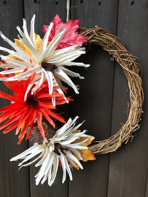 Completed wreath hanging on a wooden door