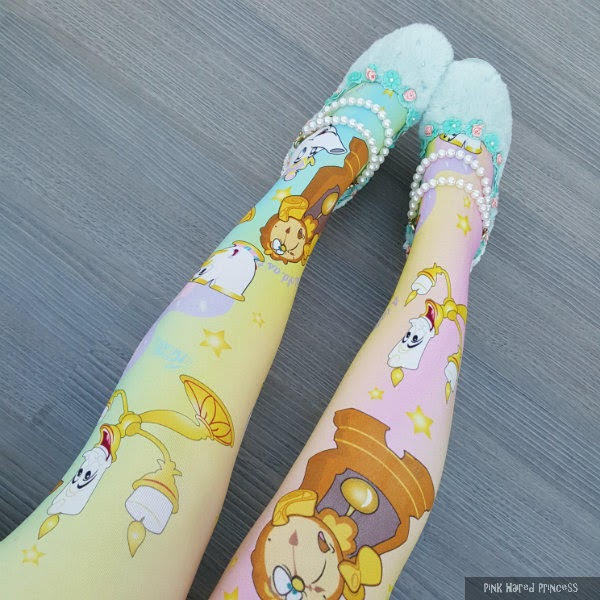front of legs wearing disney beauty and the beast tights in pastel rainbow colours