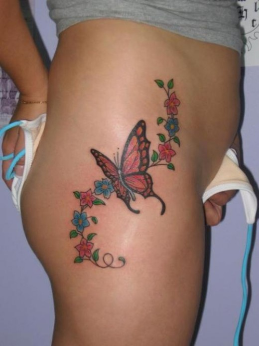 image Lower back tramp stamp tattoo slave blonde swollows