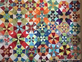 Multicolored fabrics create a cheerful, bright kaleidoscope quilt.