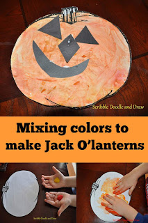 Halloween art activity for kids mixing colors to make Jack O'lanterns