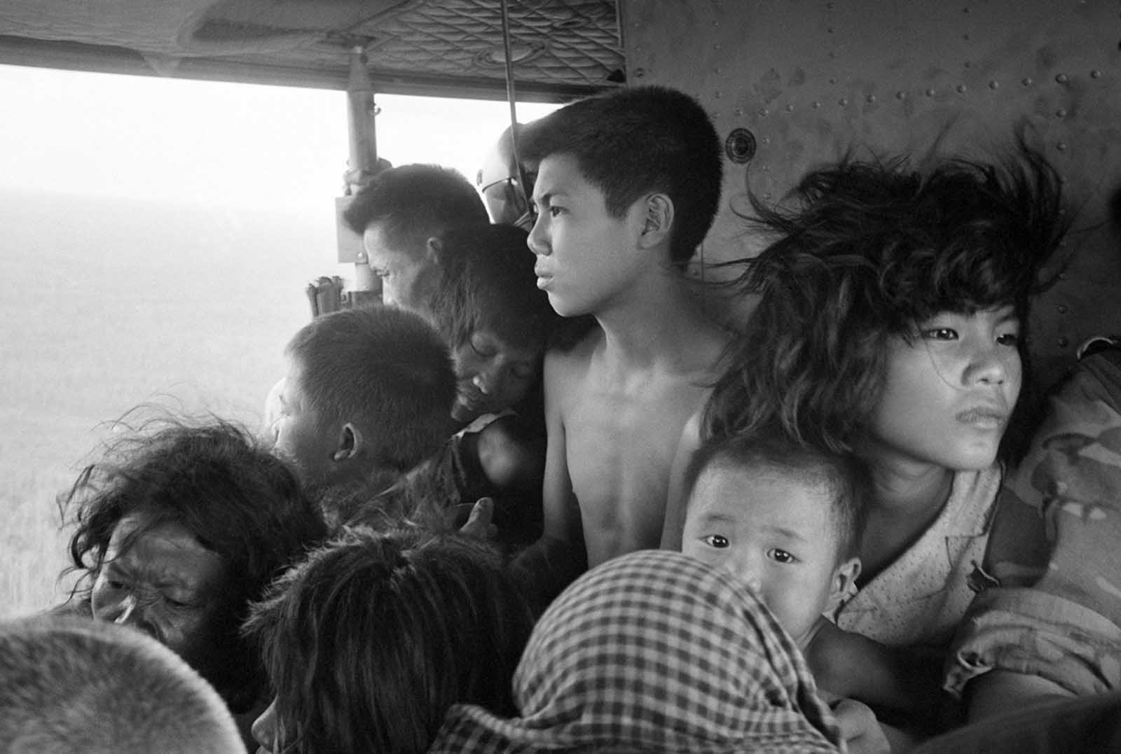Vietnamese and Cambodian refugees crowd a U.S. helicopter which evacuated them from immediate combat zone of the U.S.-Vietnamese incursion into Cambodia on May 5, 1970. They were taken to a refugee reception center at the Katum Special Forces camp in South Vietnam, six miles from the Cambodian border.