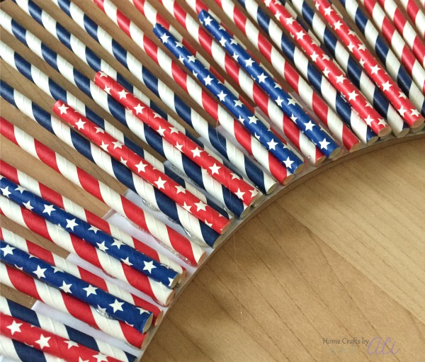 easy tutorial with images to make a red white and blue paper straw wreath