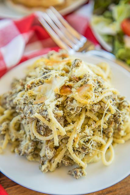 Cheesy Sausage Pesto Pasta Bake - only 6 ingredients! Sausage, spaghetti, pesto, ricotta, mozzarella and parmesan - SO good! Great make ahead pasta casserole recipe - can freeze too! There are never any leftovers. Such a quick and easy casserole recipe!! #pasta #casserole