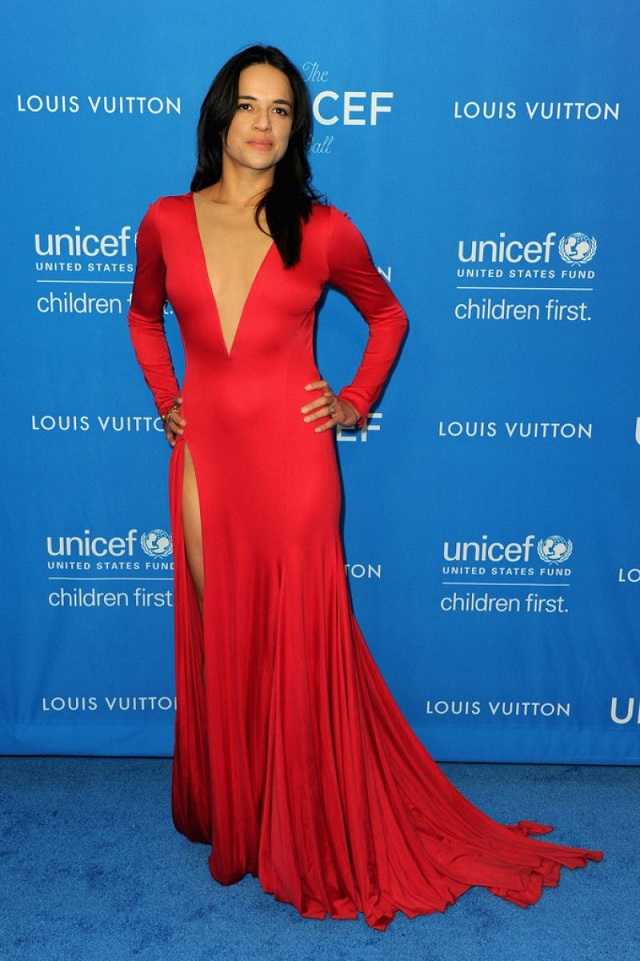 Michelle Rodriguez arrives in a low cut and backless dress to the UNICEF Ball in LA
