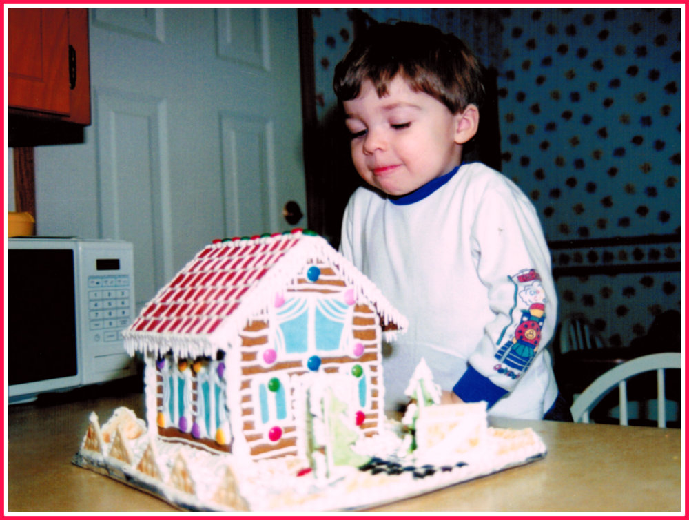 Nicholas admiring a gingerbread house December 1994