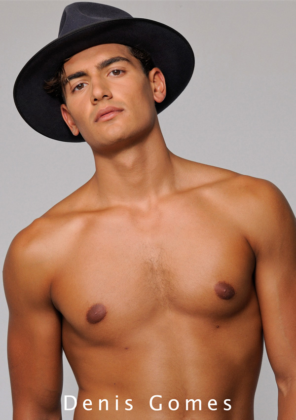 Front of comp card wearing man's Akubra hat. Men's Fashion Modelling Portfolio by Kent Johnson.