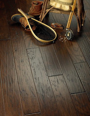 Dark brown hardwood with distinctive grain patterns