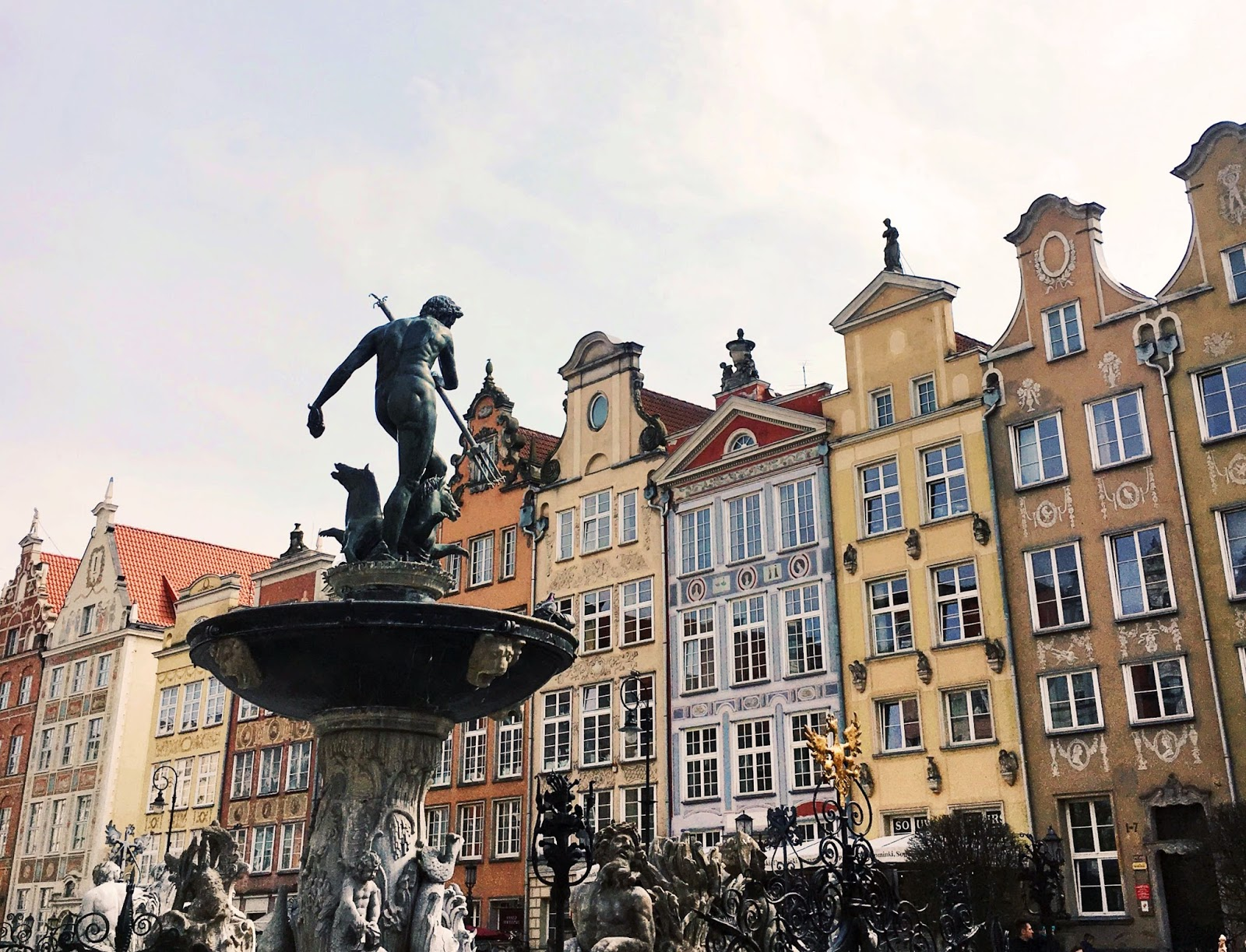 architecture in Gdansk, neptune statue fountain, travel blog