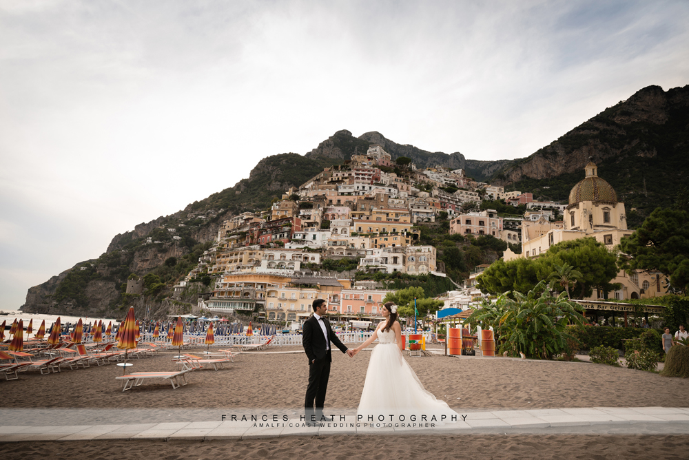 Bride and groom with view of Positano beach