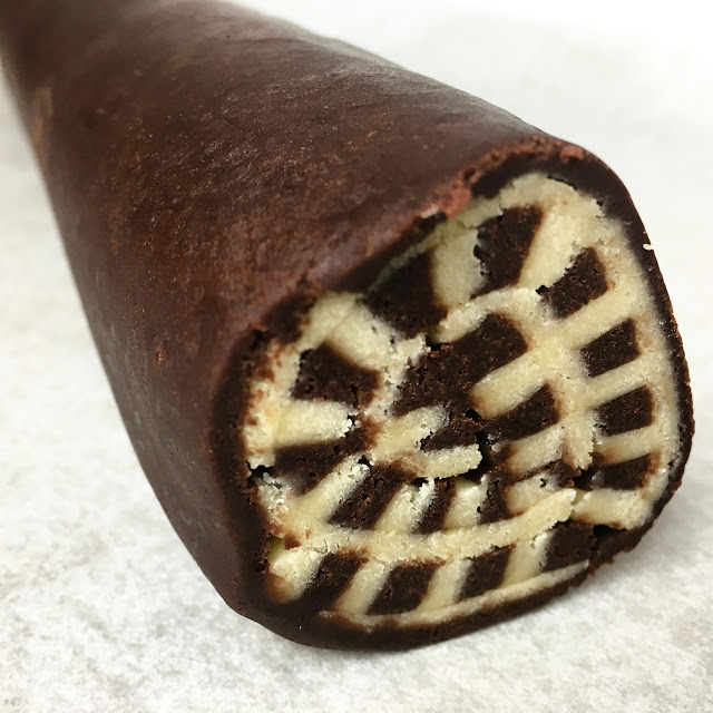Cross-section of Rolled Tube of Vanilla & Chocolate Shortbread (Pate Sablee)