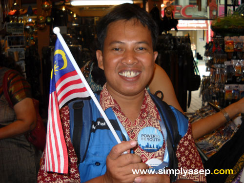 Its me holding Malaysia Flag. I am Indonesian actually. I holded the flag because of I was in Kuala Lumpur at the time the photo was taken.  IST