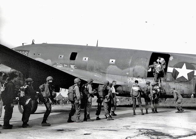 US Army soldiers boarding plane at Lipa Airstrip in 1945 for parachute practice.  Image source:  United States National Archives.