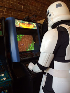 Star Wars Stormtrooper playing video game.