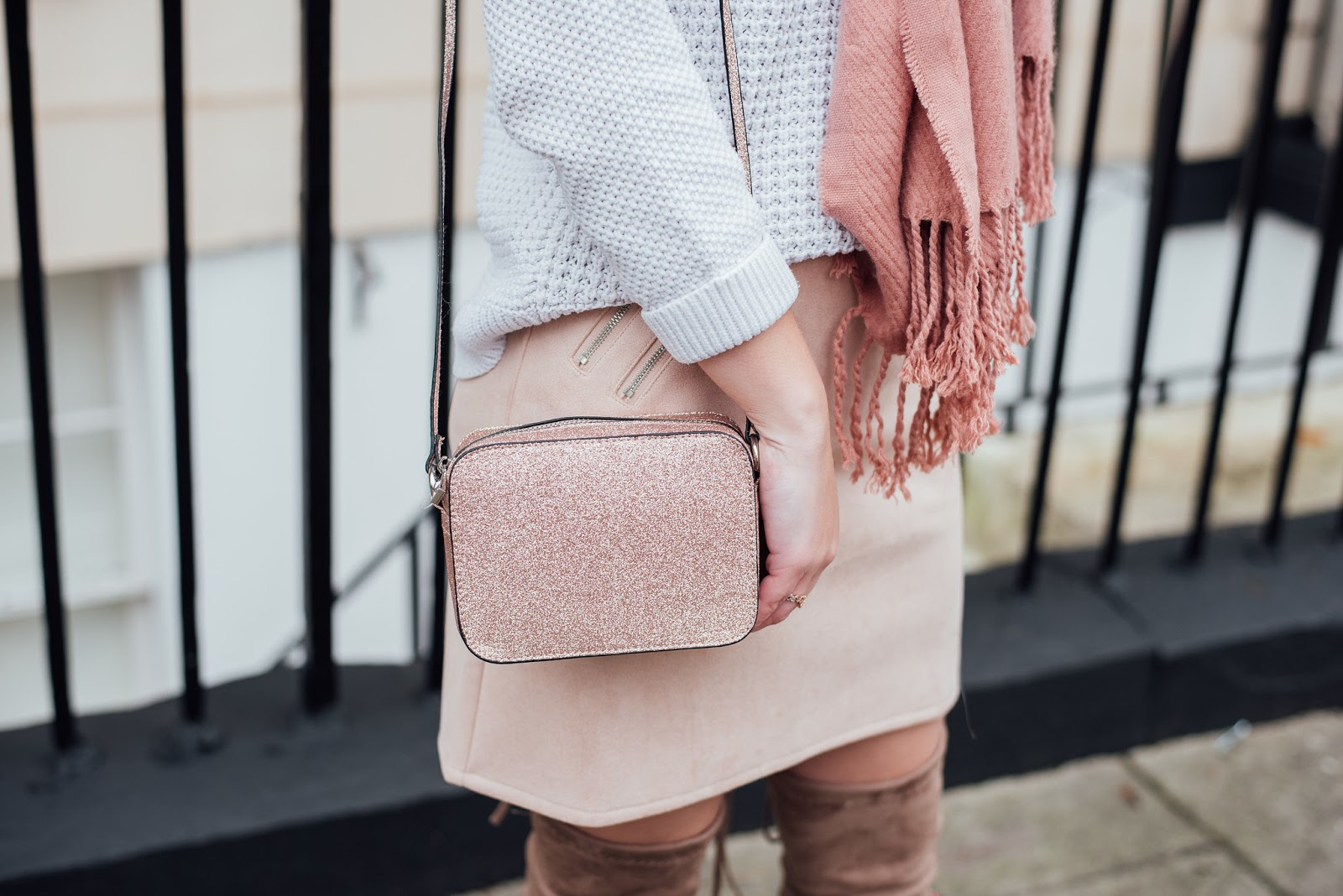 Close Up Shot of Pink Suede skirt with rose gold glitter ASOS cross body bag