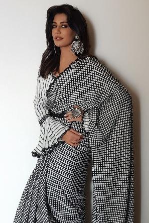 Chitrangda wore a Punit Balana black and white checkered saree