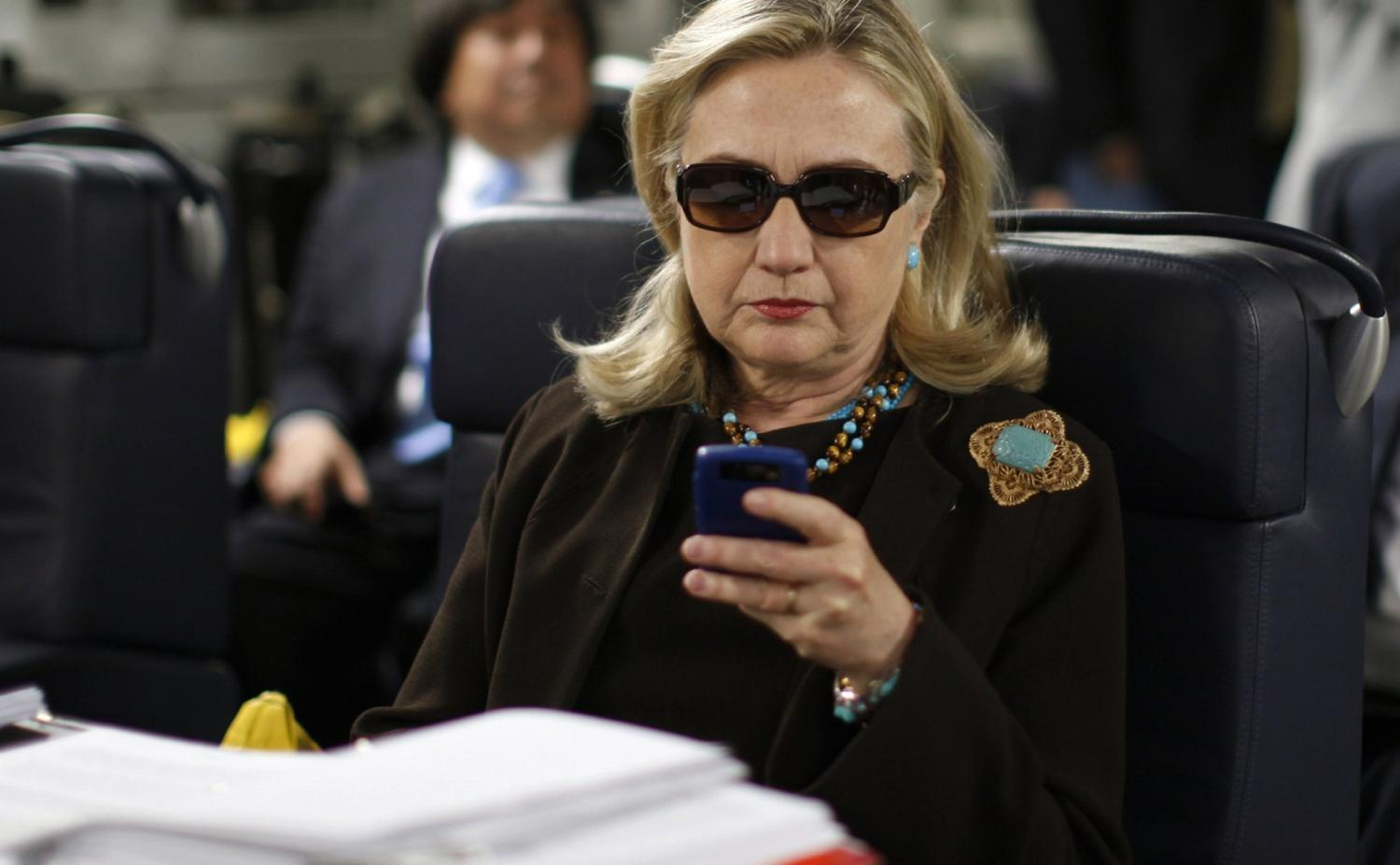 Hillary Clinton using her Blackberry