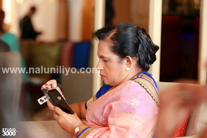 Checking iphone in Hirunika Premachandra on Her Wedding Day