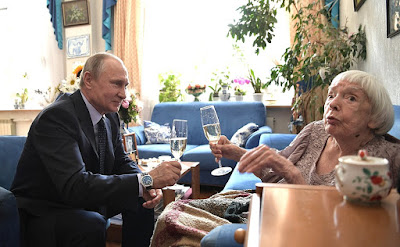 Vladimir Putin drinking champagne with Lyudmila Alexeyeva on her 90th birthday.