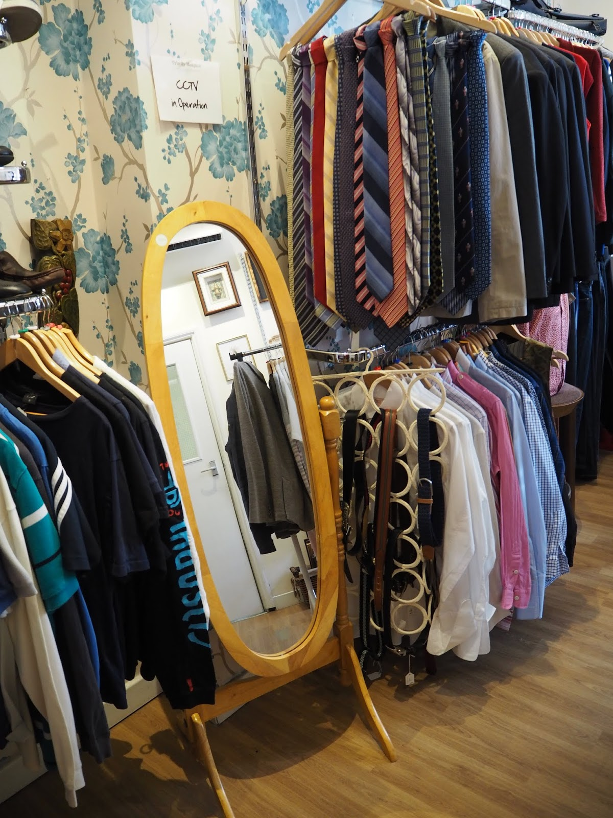 a standing mirror in a vintage shop
