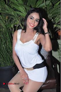 Actress Model Pooja Sri Stills in White Short Dress at F Club pre soft Launch  0136.JPG