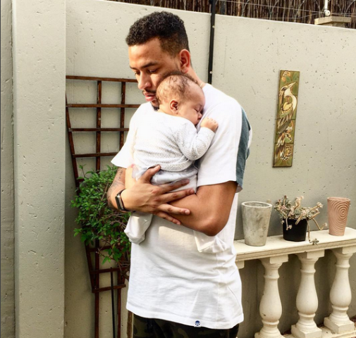 Rapper AKA with his daughter.