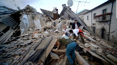 Two women killed in Italy quake, child pulled alive from rubble