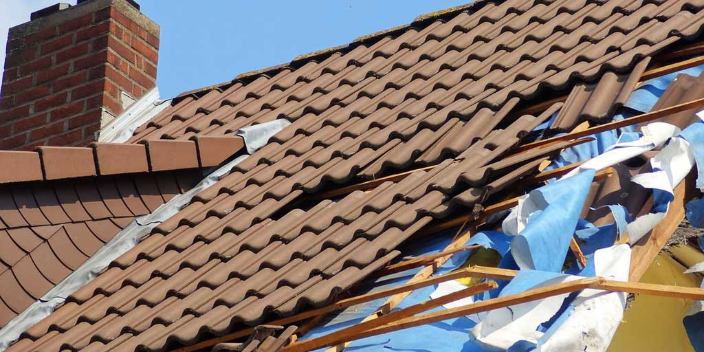 Hole in roof - illustrating underlying problem with overdraft charges
