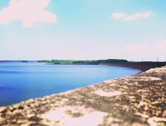 admire stunning beauty of Tri An Lake