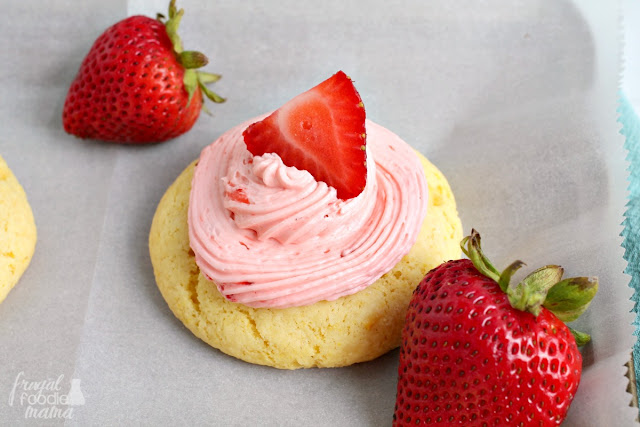 Inspired by a favorite summertime drink, these Easy Strawberry Lemonade Cookies start with a box of lemon cake mix & are topped with a fresh strawberry buttercream.