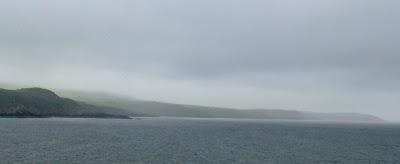 Foggy and grey around the coast, looking towards Strumble Head