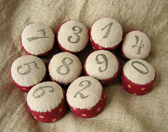 numbered pincushions