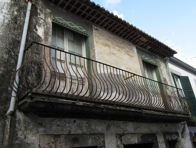 an ancient balcony that holds up in time