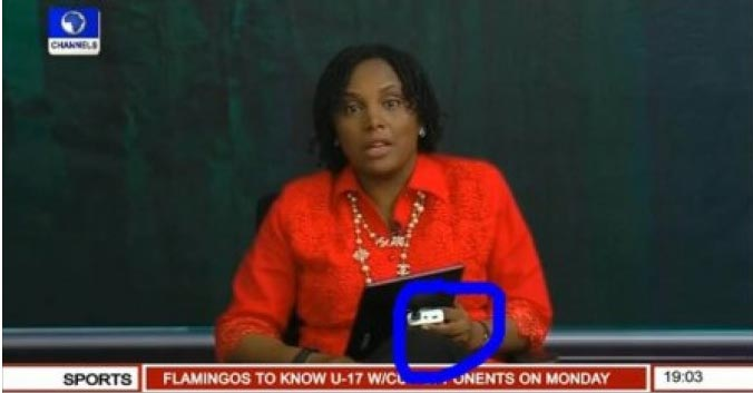 Oh no! Channels TV presenter charges tablet with powerbank on air