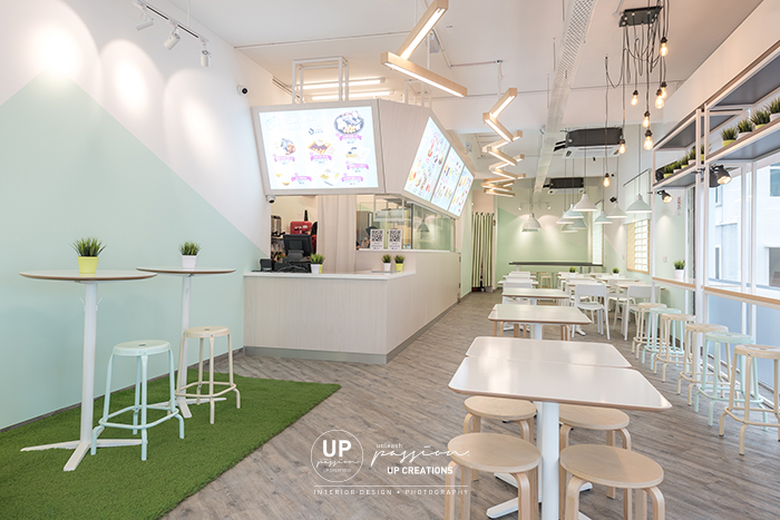 icebing dessert cafe malacca sitting and standing area table in white, cashier counter in light tone wood texture laminate finish and lightbox menu