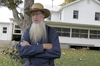 In this Oct. 10, 2011, file photo, Samuel Mullet Sr. stands in front of his home in Bergholz. Mullet has filed a motion to vacate his convictions, following the Supreme Court decision's not to take up his case.(AP file photo)