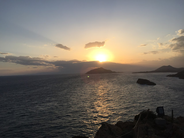 A SUNSET OVER ONE THE 6000 GREEK ISLANDS