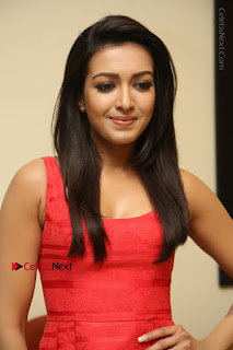 Actress Catherine Tresa Latest Pos in Red Short Dress at Intex Air Conditioners Launch  0006.jpg