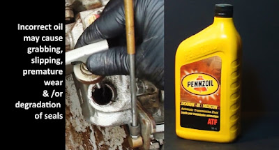 triple screen of text, a dipstick and a bottle of Pennzoil ATF