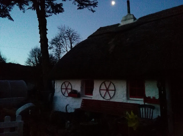 thatched cottage, blue skys