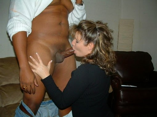 Mature lady sucks big black cock