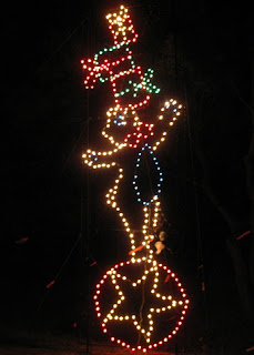 Bear balancing gifts on a ball, Fantasy of Lights